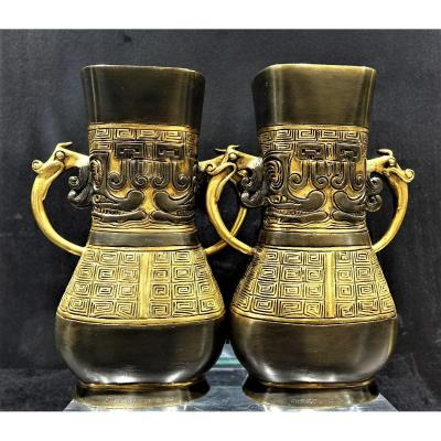 <strong>CHRISTOFLE<br /> Pair of vases with handles by Emile REIBER for the Christofle house in bronze with Japanese decor.<br /> Pansy vase with a flared neck with two handles with a dragon&#39;s head resting on scrolls.<br /> Each vase is intricately carved with geometric designs and Japanese characters. Double brown and golden patina Signed on each base <u><em>&quot;CHRISTOFLE &amp; Cie&quot;</em></u><br /> Height 16 cm, width 11.5 cm, depth 6 cm.<br /> <u><em>Circa&nbsp;1875<br /> Very good Condition</em></u><br /> <em><u>Emile-Auguste REIBER (1826-1893)</u></em><br /> Architecture graduate from the Beaux Arts in Paris, Prix de Rome in 1850, founder of the review <em><u>&quot;Art for all, encyclopedia of industrial and decorative art&quot;</u></em>.<br /> Head of the composition and drawing workshop at <em><u>Maison Christofle in 1865</u></em>, he composed numerous drawings and plans, many of which were made. In 1870, he developed a passion for Japanese art, especially after the exhibition in Paris in 1873, of the collection of Japanese bronzes by M. Cernuschi in 1873.<br /> His Japanese-style creations for the house of Christofle met with immense success both in France and in &#39;internationally, notably during the exhibitions in Vienna in 1873 and in Paris in 1878.<br /> Japanese artists even come to Europe to study his work. He left the Christofle house in 1878.<br /> His works are exhibited in many Museums including in Paris at the Mus&eacute;e d&#39;Orsay and at the Decorative Arts.</strong><br /> <br /> <br /> <br /> <br /> <br /> &nbsp;