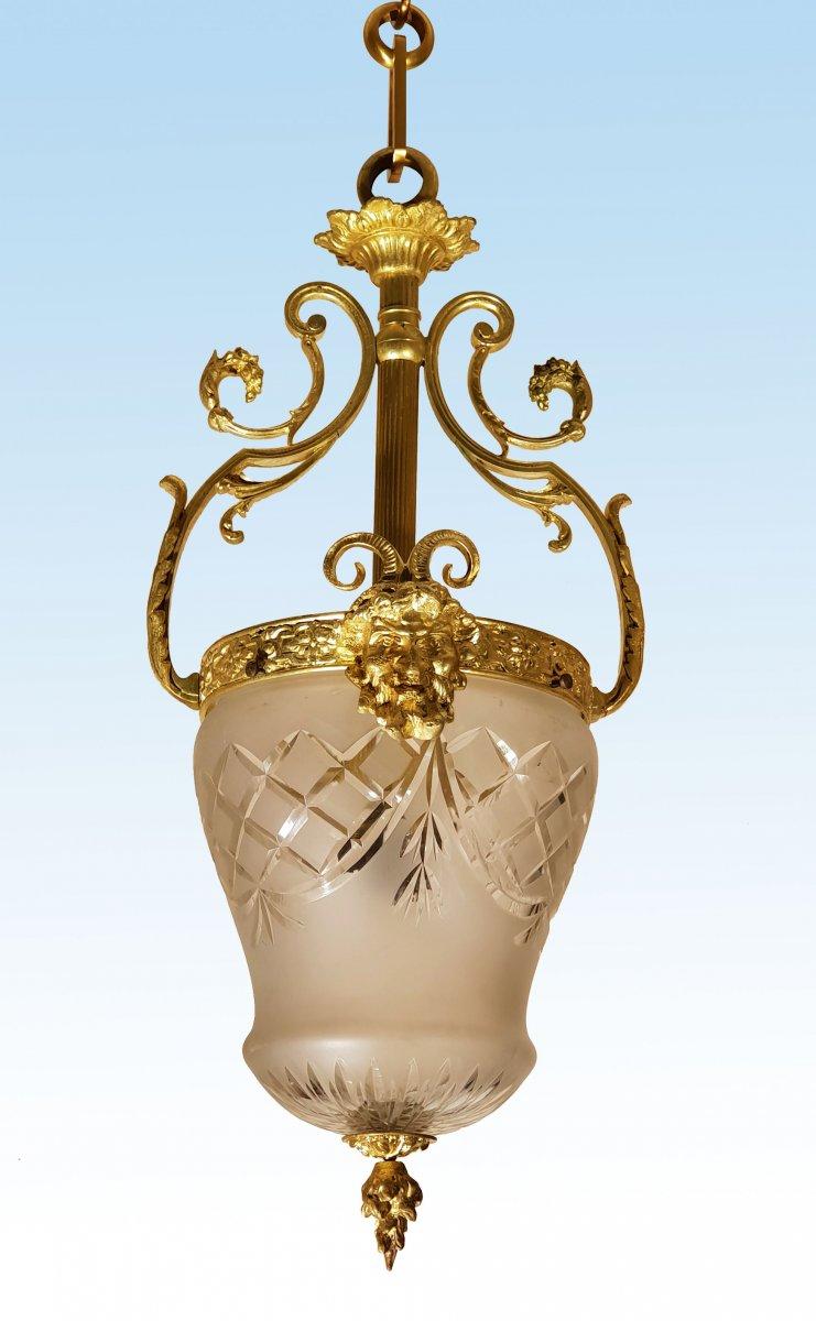"""Paire de lanternes """"aux faunes et aux béliers"""" bronze doré et verre taillé"""