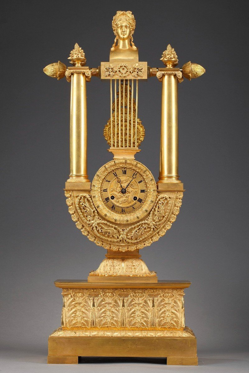 """Pendule """"lyre"""" en bronze doré de style Empire"""