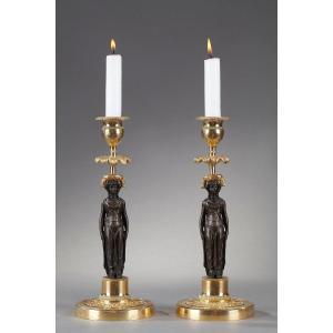 Paire De Flambeaux En Bronze Patiné Et Doré
