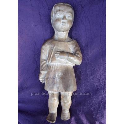 Sculpture en tilleul XVIIIème représentant un enfant