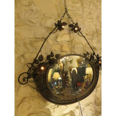 Wrought iron mirror from the Art Nouveau period .The original mirror of which&nbsp;<br /> in perfect condition bevelled&nbsp;<br /> This mirror has four lights ,electricity redone&nbsp;<br /> Created by Henri Fournet (Lyon ) whose stores and workshops were located&nbsp;<br /> in 35 street of the Part Dieu and 128 - 130 street pierre corneille&nbsp;<br /> This craftsman worked for Schneider ,Muller , Majorelle , Daum et Delate .