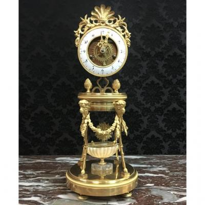 Pendule demi-squelette en bronze doré signée Gaston Jolly à Paris, époque XVIIIème