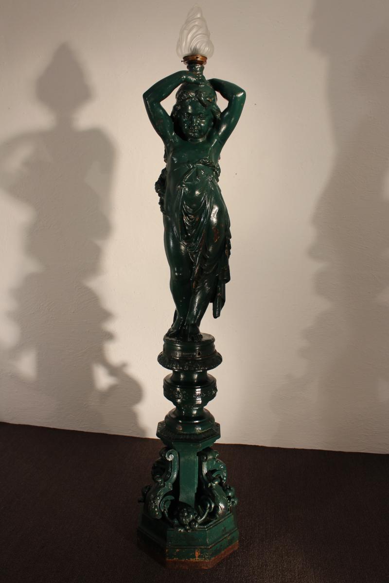 Cast Iron Torchery Statue