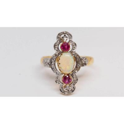 Old Ring Set With An Opal And Red Stones