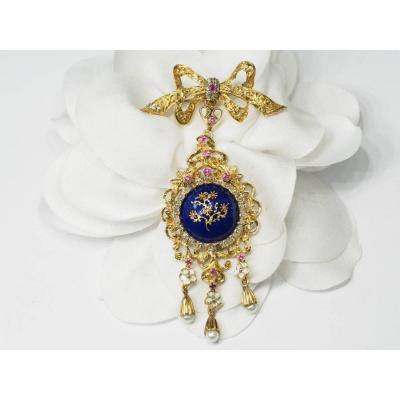 Broche pendentif en or jaune, rubis et perles
