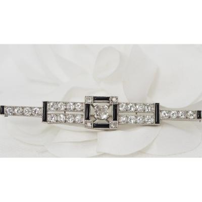 Antique Brooch In Platinum, Onyx And Diamonds