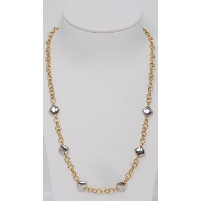 Necklace; 18 kt / 750 thousandths yellow and white gold; Composed of 6 square patterns linked together by a round convict chain; Weight: 10.70 gr; length: 50 cm