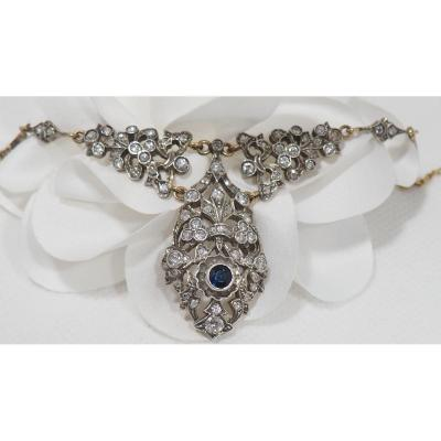 Old necklace; 18 kt / 750 thousandth yellow gold and 925 silver; Set in the center with a round sapphire; Embellished with old cut diamonds for a total weight of approximately 1.20 ct; Weight: 19.3 gr; Length: 50 cm; Pattern dimension: 5x4 cm; Period: Napoleon III.