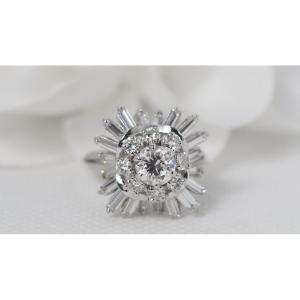 Important Flower Ring In Platinum And Baguette Diamonds