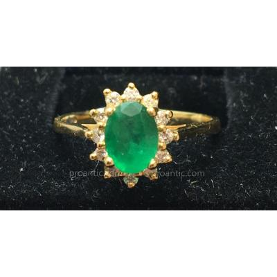 18ct Gold Ring Set With An Emerald Surrounded By Brilliants