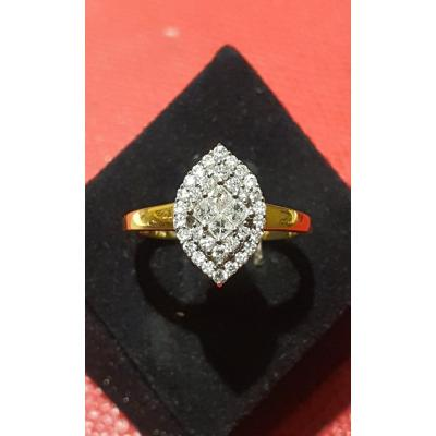 18ct Gold Marquise Ring Set With Modern Cut Diamonds Including 4 Princess Cut