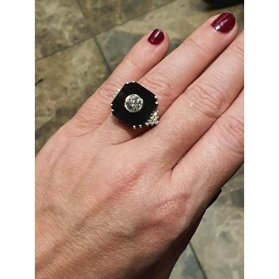 bague en or 18ct sertie d un diamant de  1,12ct et onyx noir