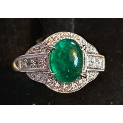 18ct Gold Ring Set With An Emerald Cabochon Surrounded By A Paving Of Brilliants