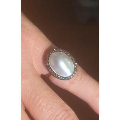 Gold And Silver Ring Set With An Oval Pearl Surrounded By A Paving Of Hematites