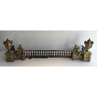 Paire De Chenets En Bronze Ciselé Figurant Un Amour
