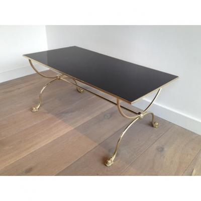 Brass Coffee Table With Dolphin Heads And Black Lacquered Glass Top.