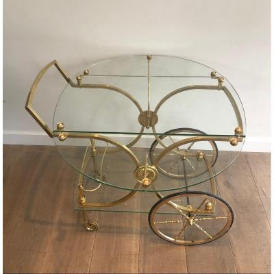 Maison Bagués. Rare Neoclassical Style Brass And Glass Drinks Trolley With Folding Rounded Glass Sides. French. Circa 1940