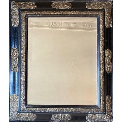 Mirror In Black Varnished Wood And Embossed And Gilded Copper, Early 18th Century