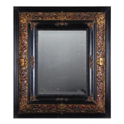 Blackened Wooden Mirror With Brass Decoration On Tortoiseshell Background Circa 1860