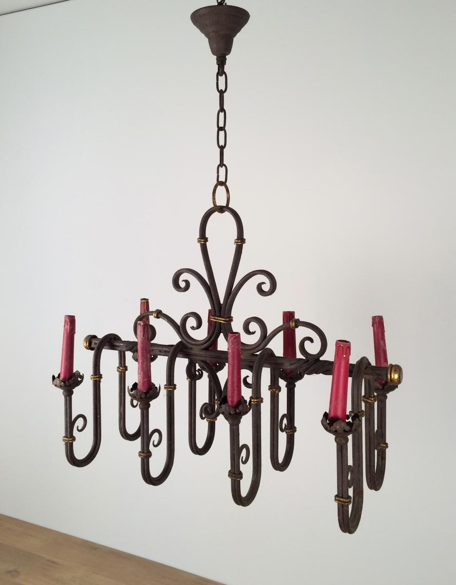 Wrought Iron Chandelier 8 Lights On. Around 1940.