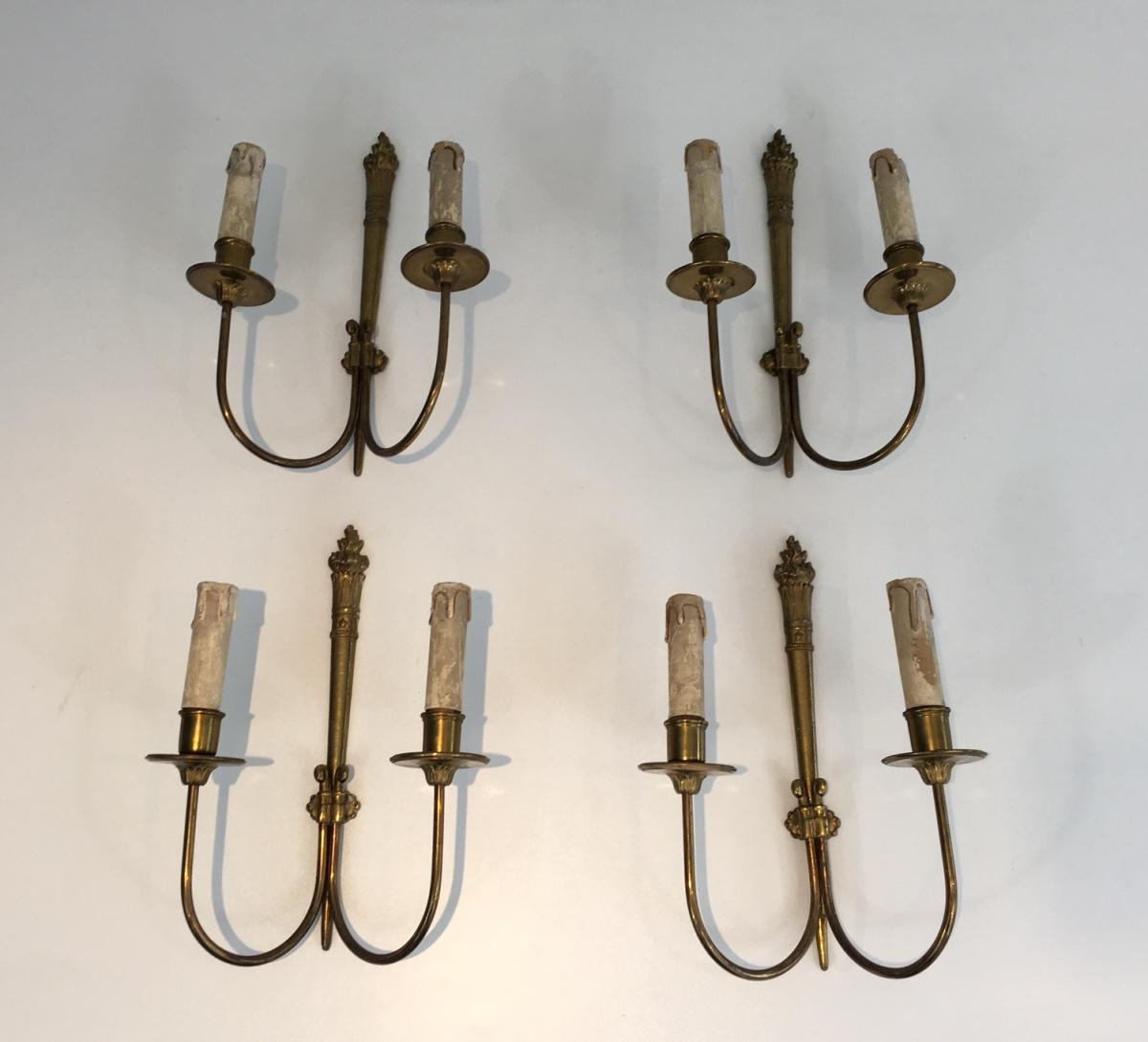 Suite Of Four Neoclassical Wall Sconces In Bronze.