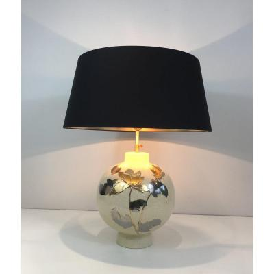 By L Drummer. Cracked Ceramic Lamp With Silver And Gold Flower Decoration On The Front. Signed.