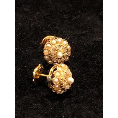 A Pair Of Niii Earrings