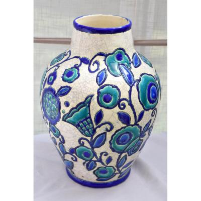 Large earthenware vase with ovoid body and curved neck.<br /> Decorated with flowers and stems in blue and green cloisonn&eacute; enamels surrounded by black on a milky white crackle background.<br /> Signed with the factory stamp and marked La Ma&icirc;trise.<br /> There is a hole to be able to mount it as a lamp.<br /> <br /> Height: 32 cm - Neck diameter: 10cm<br /> <br /> <em><strong>Transport for France: &euro; 21 - Europe: &euro; 40 - Rest of the world: &euro; 116</strong></em>
