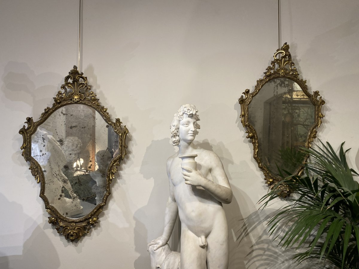 Paire de Miroirs en bois sculpté et doré , XIXème siècle