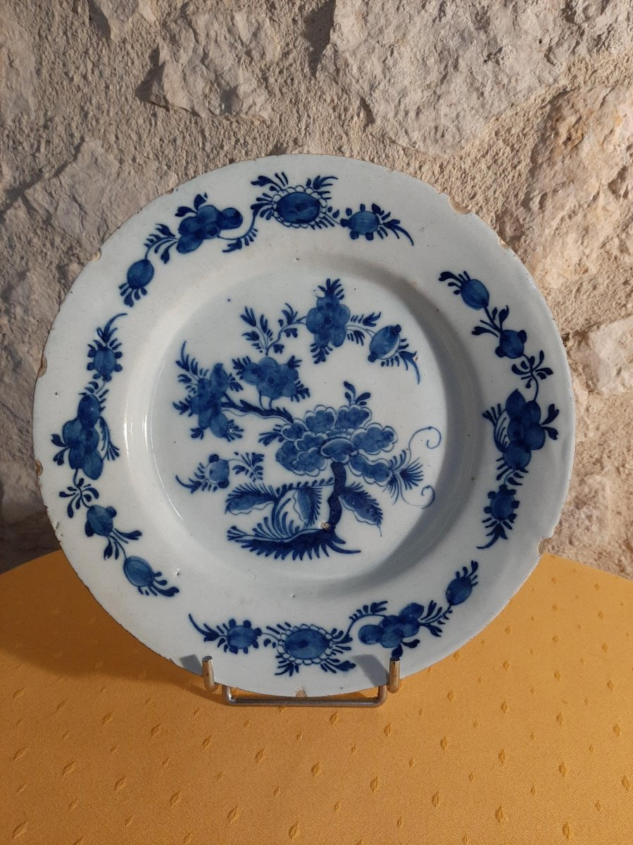 Delft Earthenware Plate Decorated With Flowers Of Far Eastern Inspiration From The 18th Century
