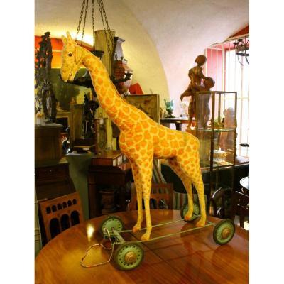 Jouet Ancien , Tres Grande Girafe Sur Roulettes En Tissus Et Paille