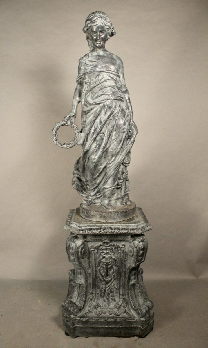 Young Woman Draped In Cast Iron On Base