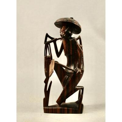 Statue in exotic wood representing an Asian farmer. Red exotic wood. Fine details on the face. The plague held in the left hand is removable.