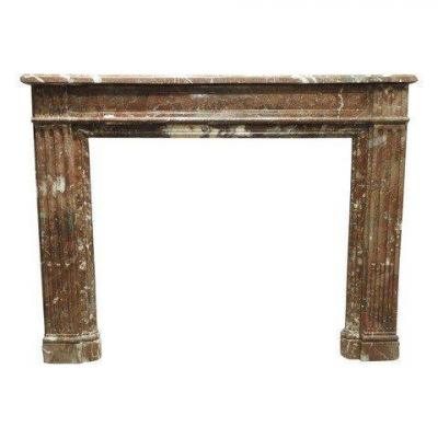 Early 19th Century Fireplace in &#39;Rouge Belge&#39; Marble.<br /> Inside dimensions : 93cm wide and 82cm high<br /> PRICE : 21\% VAT EXCL !