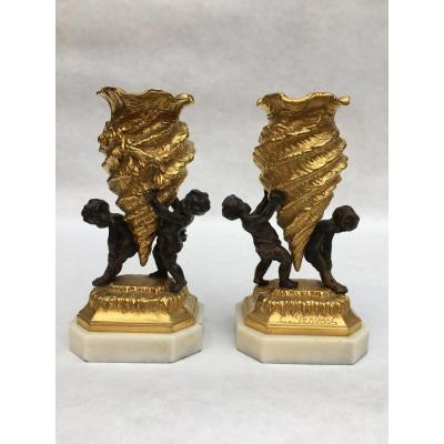 Two Elegant Gilt Bronze And Patinated Table Vases On White Marble Bases