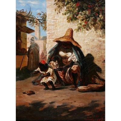 Juliette G. , Femme du Maroc et son enfant jouant avec une tortue