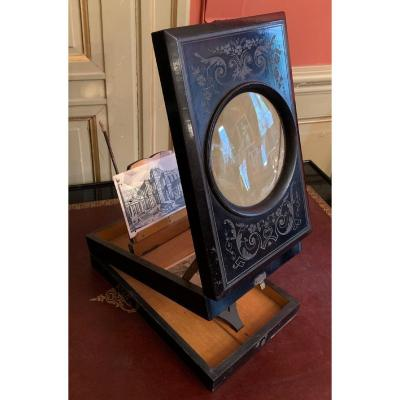 <br /> Ebony veneer box receiving a magnifying glass on the cover to view postcards or photos.<br /> Opening in two parts (see photos).<br /> Adjustable in inclination and depth, foldable in a box.<br /> Veneer jump on the front.<br /> Napoleon III period.<br /> &nbsp;