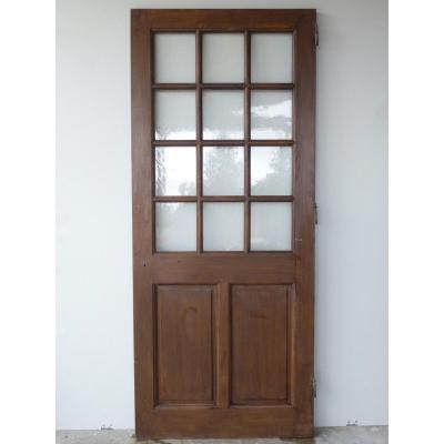 Porte en chêne vitrée