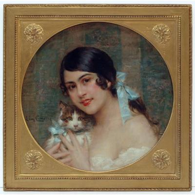 L&eacute;on Fran&ccedil;ois COMERRE (1850-1916) Young Lady With Kitten Oil on canvas signed left Old frame re-gilded with leaves Dim canvas : 50 X 50 cm Dim frame : 61 X 61 cm COMERRE L&eacute;on Fran&ccedil;ois (1850-1916) French painter born 10 October 1850 in Tr&eacute;lon (North of France) Dead 20 February 1916 in Paris. He was taught by Alphonse-Victor Colas (1818-1887) in Lille and Alexandre Cabanel (1823-1889) at the Ecole des Beaux-arts in Paris. He was Grand Prix of Roma in 1875. He got a bronze medal at the Salon of Paris in 1875, an other reward in 1881, then an honor medal for the World Fair of Anvers in 1885. He was made chevalier de la l&eacute;gion d&rsquo;honneur. He was appointed on contest for decorating the function room at the city Hall of Paris IV, and at the Lyon Prefecture. Bibliographie : Dictionary of Artists E. Benezit Book III /811<br />