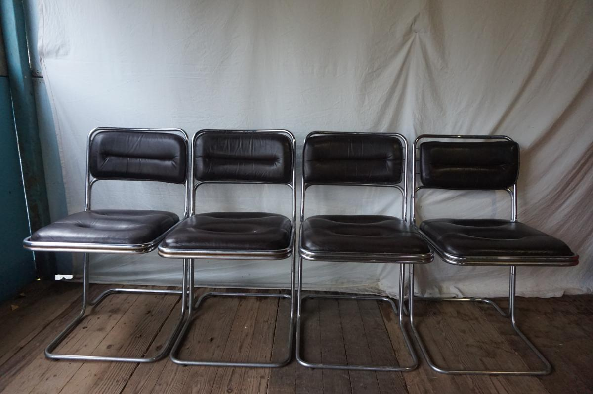 Suite 4 Chairs Chromed Metal And Black Leather