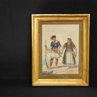 Couple de personnages en costumes régionaux italiens