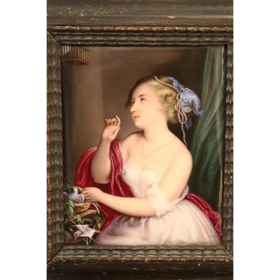 """Young girl with the dove"" painted on porcelain, Old Paris, 1830, first half of the 19th century. An exceptional finesse of execution and great freshness of colors emerges from this painting on porcelain. A melancholy fat emerges from her portrait of a young girl who seems lost in her dreams. A carved wooden frame accompanies this painting, it dates from the 17th century. Private Collection, Paris. In perfect condition. Dimensions, Frame: Height: 26 cm, Width: 23 cm, Plate: Height: 17.5 cm, Width: 14.5 cm."
