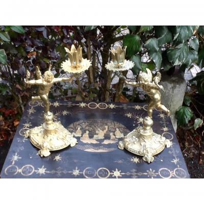 Pair Candlesticks With Cherubs In Bronze