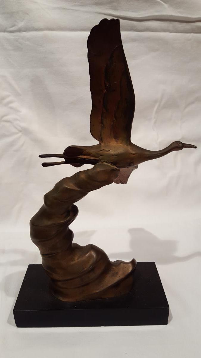 Bronze Crane In Flight