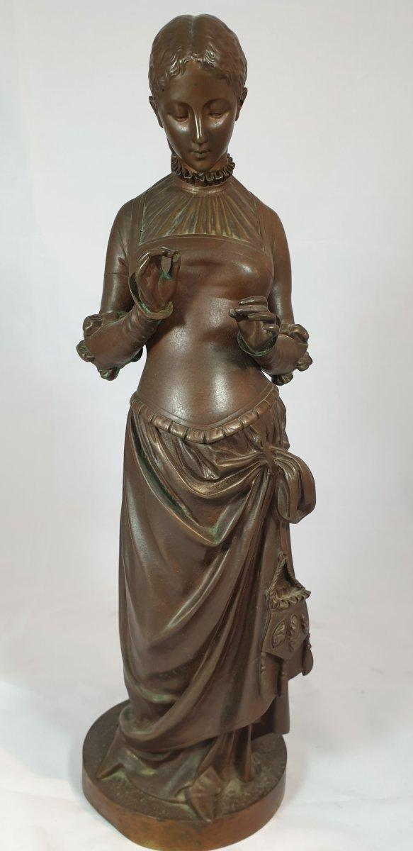 Statue De Femme à La Natte En Bronze