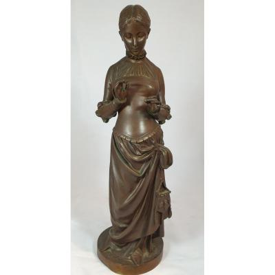 Statue Of Woman With Mat In Bronze