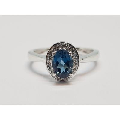 18k White Gold Ring Topaz 0.98 Carat & Diamonds 0.06 Carat 3.77 Grams