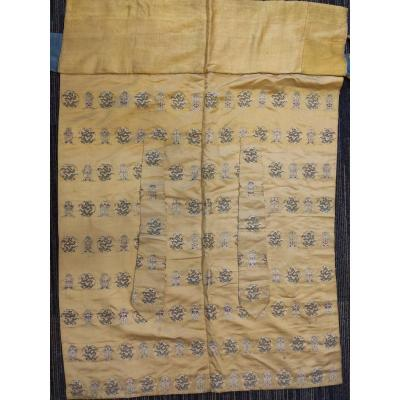 <br /> Yellow silk temple textile, imperial color, decorated with embroidered medallions with alternating decoration of five-claw dragons and Buddhist symbols adorned with the head of lingzhi (longevity mushroom)<br /> China eighteen nineteen century