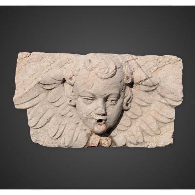 Sculpture bas-relief bouche de fontaine en marbre représentant une tête d'ange
